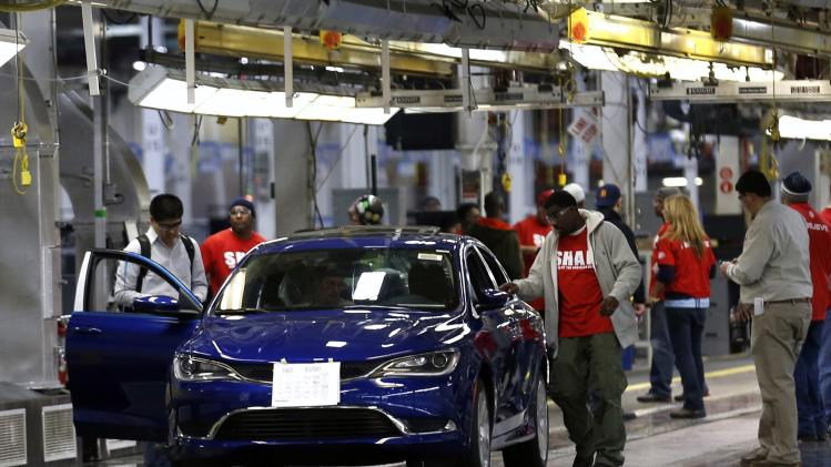 Chrysler assembly workers inspect a 2015 Chrysler 200 vehicle as it makes its way down the production line at the Sterling Heights Assembly Plant in Michigan