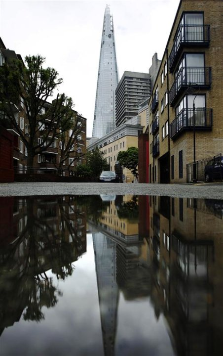 The Shard is reflected in …