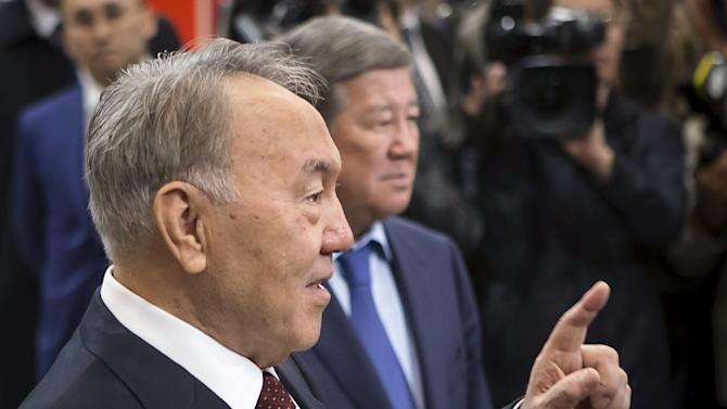 Kazakhstan's President and presidential candidate Nursultan Nazarbayev gestures during the opening of the Moscow station of the Almaty metro system