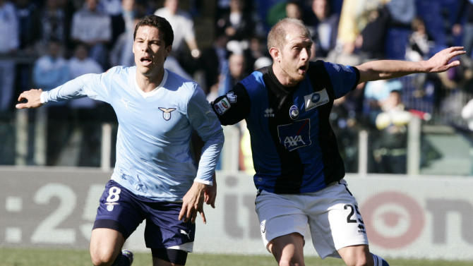 Lazio midfielder Hernanes, of Brazil, left, and Atalanta defender Andrea Masiello fight for the ball during a Serie A soccer match, at Rome's Olympic stadium, Sunday, Jan. 15, 2012. (AP Photo/Riccardo De Luca)