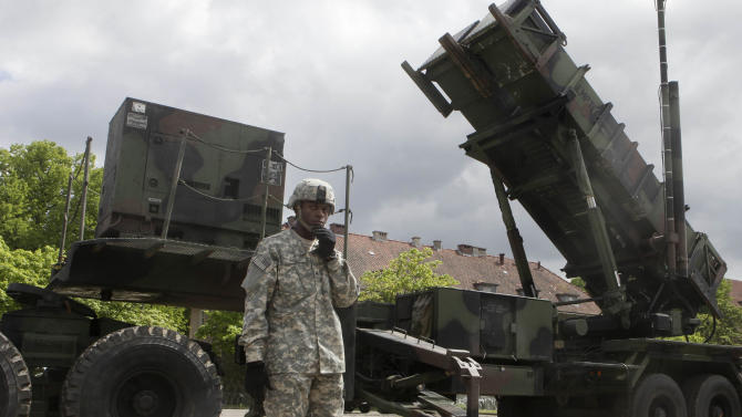 FILE - In this May 26, 2010 file photo, a U.S. soldier stands next to a Patriot surface-to-air missile battery at an army base in Morag, Poland. Turkey's government requested the deployment of NATO's Patriot surface-to-air missiles on Wednesday, Nov. 21, 2012 to bolster its defenses along its border with Syria and prevent a spillover of the civil war in that nation, officials said. (AP Photo/Czarek Sokolowski, File)