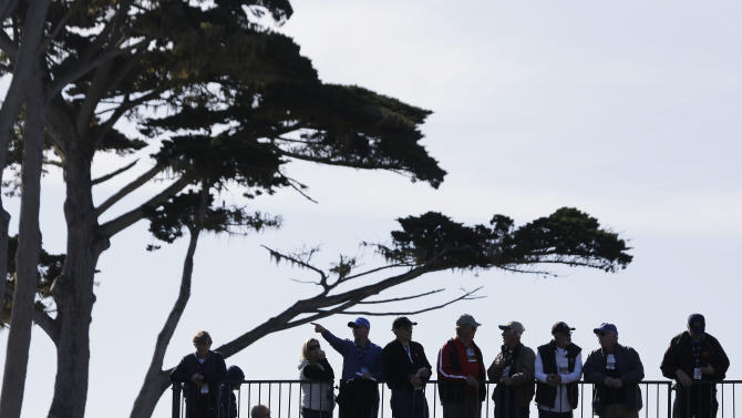 Fans above the fourth tee of the Pebble Beach Golf Links watch the final round of the AT&T Pebble Beach Pro-Am golf tournament on Sunday, Feb. 10, 2013, in Pebble Beach, Calif. (AP Photo/Eric Risberg)
