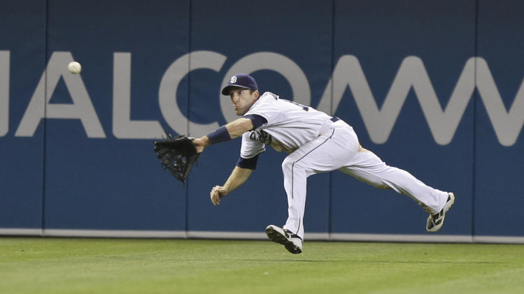 San Diego Padres left fielder Chris Denorfia makes diving catch to rob St. Louis Cardinals' Allen Craig of a hit in the ninth inning of the Padres' 4-2 victory in a baseball game in San Diego, Monday, May 20, 2013. (AP Photo/Lenny Ignelzi)