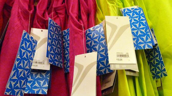 In this Thursday, Dec. 20, 2012, photo, tagged merchandise hangs on a rack at an Old Navy store in Methuen, Mass. Lower gas costs offset more expensive food and higher rents to keep a measure of U.S. consumer prices flat in December. The Labor Department said Wednesday, Jan. 16, 2013, that food prices increased 0.2 percent in December from November. Rents and airline fares also rose. Gasoline prices fell a seasonally adjusted 2.3 percent. (AP Photo/Elise Amendola)