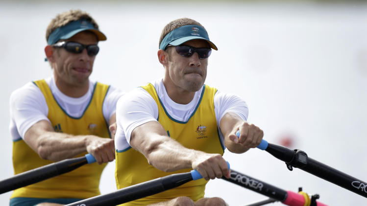 Australia's Scott Brennan, right, and David Crawshay stroke during a men's rowing double sculls repechage in Eton Dorney, near Windsor, England, at the 2012 Summer Olympics, Sunday, July 29, 2012. (AP Photo/Natacha Pisarenko)