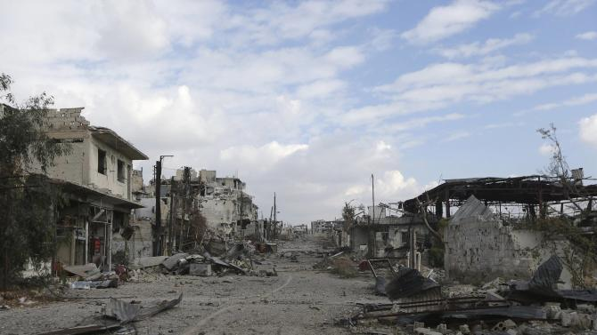 A general view shows damaged buildings along a deserted street in the rebel-held area of Jobar