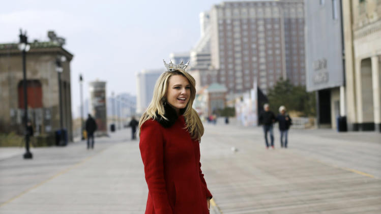 Miss New Jersey 2012 for the Miss America pageant, Lindsey Petrosh, of Egg Harbor City, N.J., walks along the Boardwalk, Thursday, Feb. 14, 2013, in Atlantic City, after New Jersey Lt. Gov. Kim Guadagno announced that the Miss America pageant is returning to Atlantic City. The pageant returns to Atlantic City in September after spending six years in Las Vegas. (AP Photo/Mel Evans)
