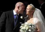 Britain's Zara Phillips, granddaughter of Britain's Queen Elizabeth, kisses her husband, England rugby star Mike Tindall, after their marriage at Canongate Kirk in Edinburgh, Scotland July 30, 2011. (AP Photo/Dylan Martinez, pool)