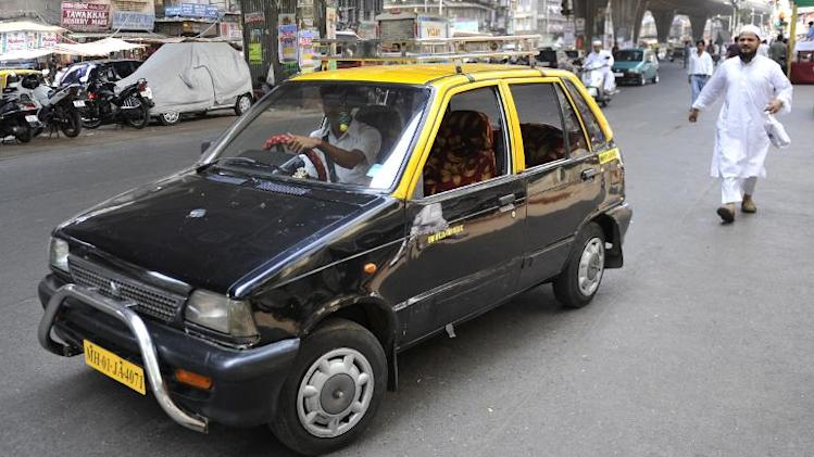 A compressed natural gas (CNG) Maruti 800 taxi in Mumbai on March 28, 2010