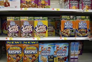 Boxes of Kellogg's cereal are displayed on store shelf…