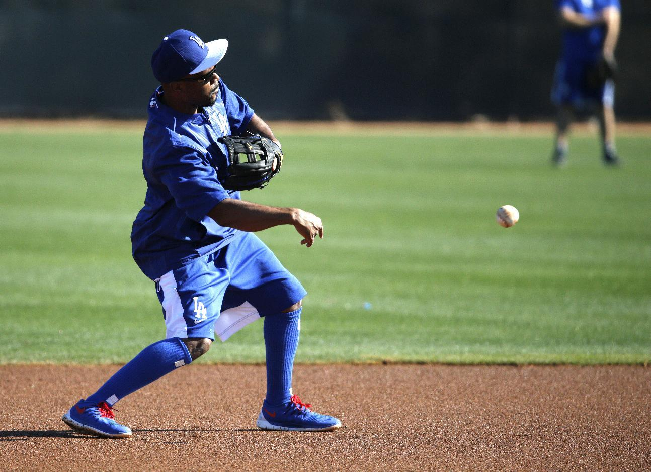 Jimmy Rollins adjusts to new uniform back home in California