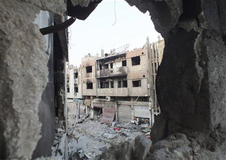 A view shows damaged buildings in the besieged area of Homs