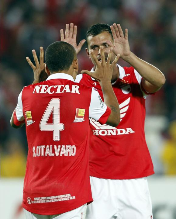 De la Cuesta of Santa Fe celebrates with teammate Otalvaro during their Libertadores Cup soccer match against Morelia in Bogota