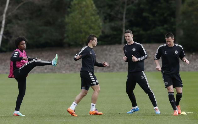 Chelsea's Willian, Cesar Azpilicueta, Gary Cahill and John Terry take part in a team training session at their training ground in Cobham
