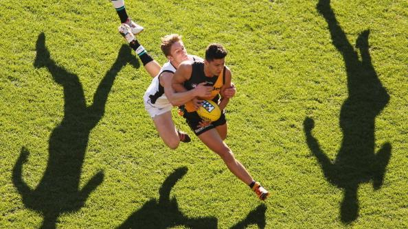Robin Nahas of the Tigers is tackled during the round 23 AFL match between the Richmond Tigers and the Port Adelaide Power at the Melbourne Cricket Ground on September 2, 2012 in Melbourne, Australia. (Photo by Scott Barbour/Getty Images)
