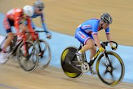 Czech Republic's Jarmila Machacova (R) competes to win the gold medal in UCI Track Cycling World Championships Women's 25 km Point Race in Belarus' capital of Minsk on February 23, 2013
