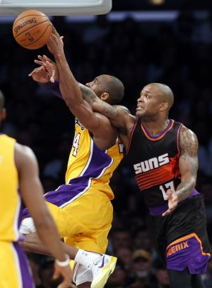 Phoenix Suns' P.J. Tucker, right, fouls Los Angeles Lakers' Kobe Bryant during the first half of an NBA basketball game on Tuesday, February 12, 2013, in Los Angeles. (AP Photo/Danny Moloshok)