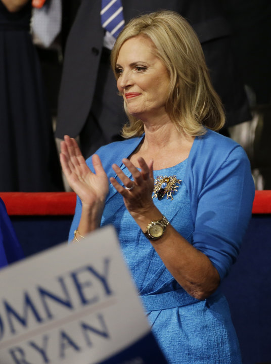Ann Romney, wife of U.S. Republican presidential nominee Mitt Romney, applauds as actor Clint Eastwood speaks during the Republican National Convention in Tampa, Fla., on Thursday, Aug. 30, 2012. (AP