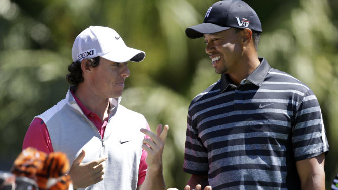 FILE - In this March 7, 2013, file photo, Tiger Woods, right, talks with Rory McIlroy, of Northern Ireland, as they wait to tee off at the 13th tee during the first round play at the Cadillac Golf Championship in Doral, Fla. McIlroy sent a text message to Tiger Woods on Tuesday, mach 26, 2013, congratulating him on winning at Bay Hill and taking over the No. 1 world ranking again. (AP Photo/Wilfredo Lee, File)