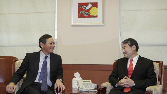 Japan's Vice Foreign Minister Saiki speaks with his South Korean counterpart Cho during a meeting at the Foreign Ministry in Seoul