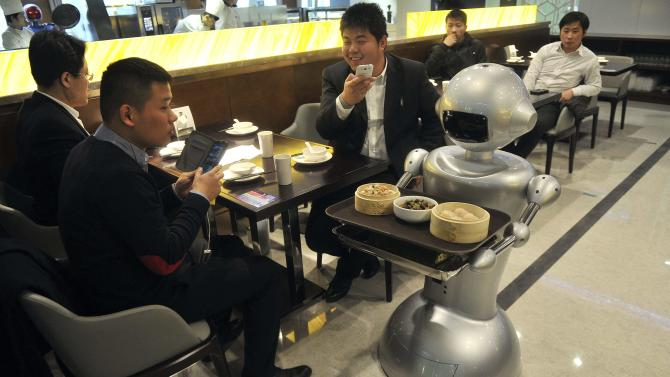 A robot delivers dishes at a restaurant in Hefei