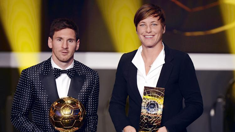 Argentina`s Lionel Messi, left, and US Abby Wambach, right, pose with their trophies after winning the World Player of the Year Awards during the FIFA Ballon d'Or Gala 2013 held at the Kongresshaus in Zurich, Switzerland, Monday, Jan. 7, 2013. (AP Photo/Keystone, Walter Bieri)
