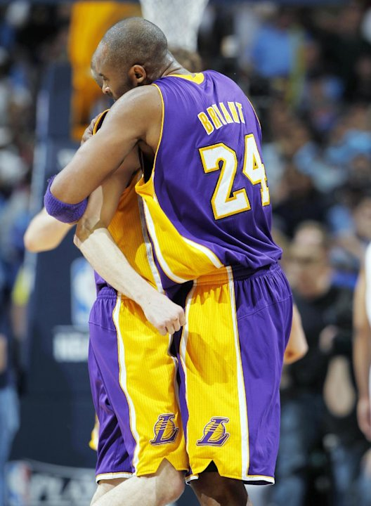 Los Angeles Lakers guard Kobe Bryant, right, hugs guard Steve Blake after he hit a key three-point basket against the Denver Nuggets late in the fourth quarter of the Lakers' 92-88 victory in Game 4 o
