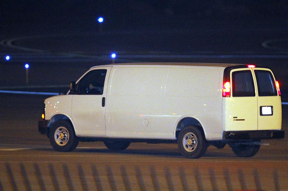 A white van, believed to be transporting Staff Sgt. Robert Bales, leaves Kansas City International Airport Friday, March 16, 2012, in Kansas City, Mo. Bales is is accused of gunning down 16 Afghan women and children. (AP Photo/Ed Zurga)
