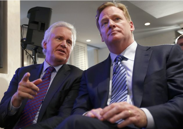 Jeff Immelt, Chairman and CEO of General Electric and Roger Goodell, Commissioner of the National Football League (NFL), speak together during a news conference announcing the Head Health Initiative i