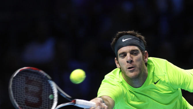 Juan Martin Del Potro of Argentina plays a return to Roger Federer of Switzerland, during their singles tennis match at the ATP World Tour Finals,  in London, Saturday, Nov. 10, 2012.  (AP Photo/Sang Tan)