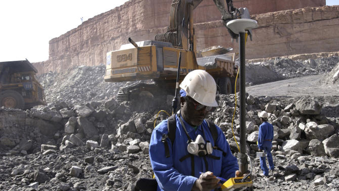 This undated file photo provided by French nuclear manufacturer Areva shows workers at the uranium mine of Arlit, northern Niger. Attackers in Niger detonated two car bombs at dawn on Thursday, May 23, 2013, one in the city of Agadez where a military barracks was targeted and one in Arlit where a French company operates a uranium mine, injuring more than a dozen people. Paris-based nuclear giant Areva said in a statement that 13 employees were hurt in the attack in Arlit, in the northern part of Niger where in 2010, al-Qaida's branch in Africa kidnapped five French citizens working for the mining company.(AP Photo/AREVA/HO) NO SALES - MANDATORY CREDIT: AREVA