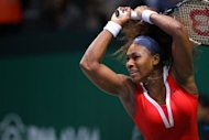 Serena Williams of the USA returns the ball to Li Na of China during their match at the round-robin stage of the WTA Championships tennis tournament in Istanbul. Serena overcame the emotions which impelled her to smash a racket and earned her a code violation warning before advancing to the verge of the semi-finals with a 7-6 (7/2), 6-3 win
