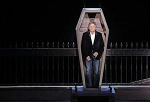 """Polish-French film director Polanski stands inside a coffin as he takes part in the presentation of the musical """"Le Bal des Vampires"""" (Dance of the Vampires) at the Mogador theater in Paris"""