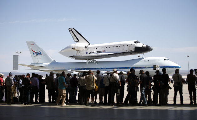 The Space Shuttle Endeavour sits atop NASA's Shuttle Carrier Aircraft (SCA) at the NASA Dryden Flight Research Center at Edwards Air Force Base, Calif., Thursday, Sept. 20, 2012. Endeavour returned to its California roots after a wistful cross-country journey that paid homage to NASA workers and former Arizona Rep. Gabrielle Giffords and her astronaut husband. (AP Photo/Jae C. Hong)