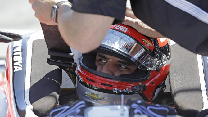 Juan Pablo Montoya, of Colombia, is readied in his car before practice for the IndyCar auto race Saturday, Aug. 23, 2014, in Sonoma, Calif. (AP Photo/Eric Risberg)