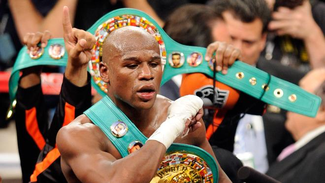 Floyd Mayweather Jr. Celebrates His Fourth-round Knockout Of Victor Ortiz To Win The WBC Welterweight Title September Getty Images