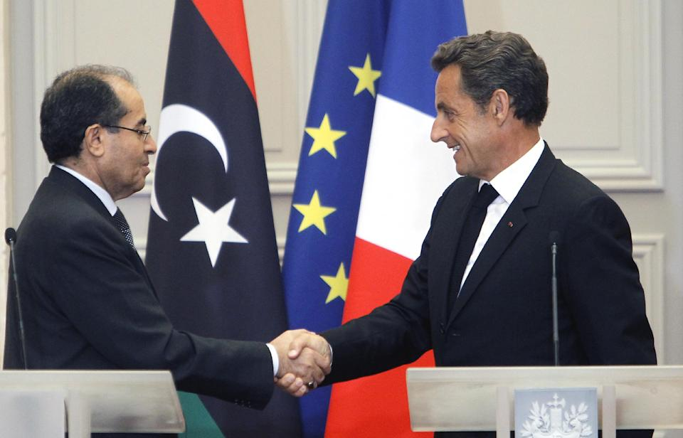 France's President Nicolas Sarkozy, rigth, shake hands with  the head of Libya's opposition government Mahmoud Jibril after at their meeting at the Elysee Palace in Paris. Wednesday, Aug. 24, 2011. (AP Photo/Jacques Brinon)
