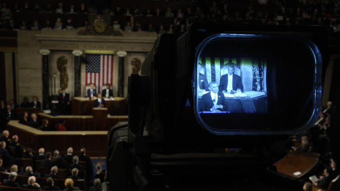 President Barack Obama is seen through a television camera viewfinder as gives his the State of the Union address on Capitol Hill in Washington, Tuesday Jan. 28, 2014. (AP Photo/Susan Walsh)