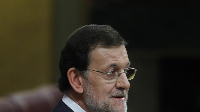 Spain's Prime Minister Mariano Rajoy speaks during a control session at the Spanish Parliament, in Madrid, Spain, Wednesday, July 11, 2012. Spain has announced a euro 65 billion austerity package that includes tax hikes and spending cuts a day after winning approval from euro zone partners for a huge bailout of Spain's banks. (AP Photo/Andres Kudacki)