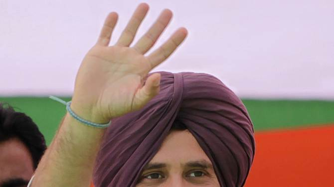 FILE - In this Jan. 25, 2012 file photo, India's ruling Congress party leader Rahul Gandhi, wearing a Sikh turban presented to him, waves at supporters during an election rally in Chabal, about 30 kilometers (19 miles) from Amritsar, India. Gandhi was appointed Vice President of the party at a special two-day long party seminar on Saturday, Jan. 19, 2013. (AP Photo/Altaf Qadri, File)