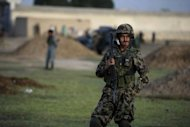An Afghan National Army soldier keeps watch during a patrol operation in the village of Wazyan, Buwri Tana district in Khost Province