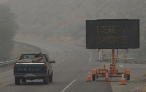 A sign warns of heavy smoke on Washington state route…