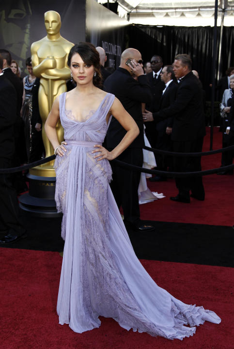 Actress Mila Kunis arrives before the 83rd Academy Awards on Sunday, Feb. 27, 2011, in the Hollywood section of Los Angeles. (AP Photo/Matt Sayles)