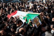 Iranians carry the coffin of a commander shot dead in Syria, during his funeral procession in Tehran on February 14, 2013. Syria's rebels captured a military airbase in the northern province of Aleppo and geared for a major battle against loyalist forces for control of two nearby strategic airports
