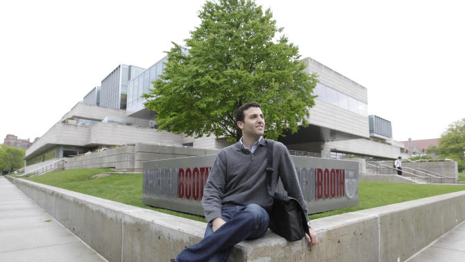 This May 2, 2012 photo shows Daniel Shani on the University of Chicago campus. In June 2012, at 25, Shani graduates with an MBA from the university's Booth School of Business. Up next: a job heading his own company, Energy Intelligence LLC, an alternative energy startup based in Massachusetts. Many of his classmates will join high-powered financial, consulting and marketing firms. But he'll be his own boss, trying to convert a bold idea into a successful venture. (AP Photo/M. Spencer Green)
