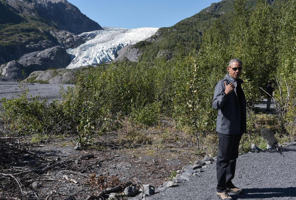 Obama tours glacier to highlight march of climate change