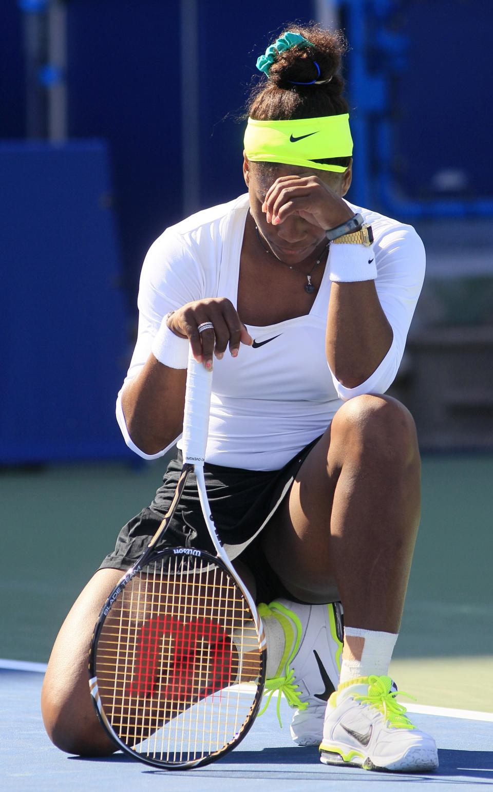 Serena Williams, of the United States, reacts after missing a point against Angelique Kerber, from Germany, during a quarterfinal at the Western & Southern Open tennis tournament, Friday, Aug. 17, 2012, in Mason, Ohio. Kerber won 6-4, 6-4. (AP Photo/Al Behrman)