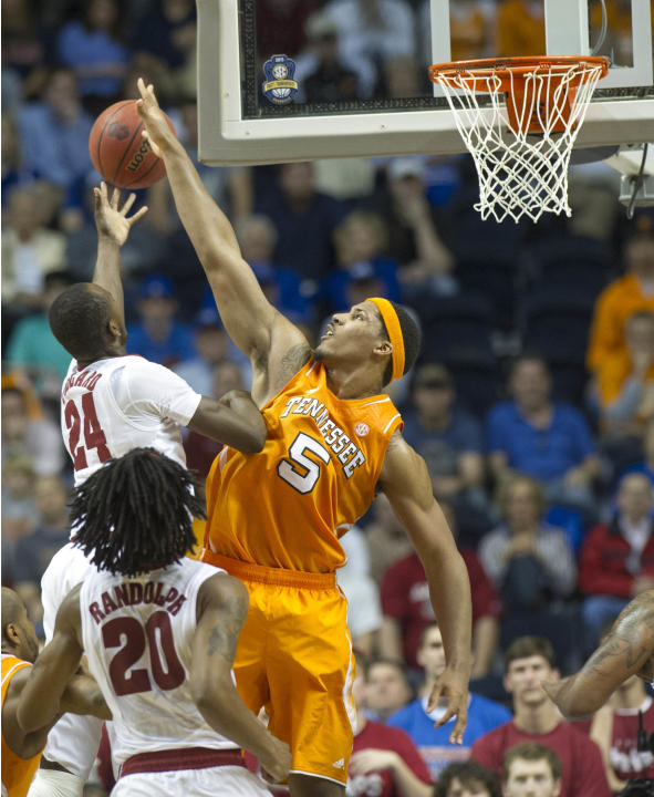In this March 15, 2013, photo, Tennessee forward Jarnell Stokes defends against Alabama's Devonta Pollard during the Southeastern Conference basketball tournament in Nashville, Tenn. Stokes received s