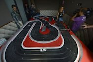 Journalists take visit the &quot;Scalextric&quot; game room at the Spain&#39;s football team base camp in the hotel Mistral Sports in Gniewino on June 15 during the Euro 2012 football championships. Spain threw open the doors of their secluded hideaway in northern Poland to offer fans a tantalising glimpse of just how European and world champions live