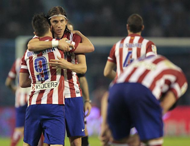 Atletico's David Villa, left, celebrates after scoring the first goal against Real Club Celta with teammate Atletico's Filipe Luis from Brazil during a Spanish La Liga soccer agains Real Club
